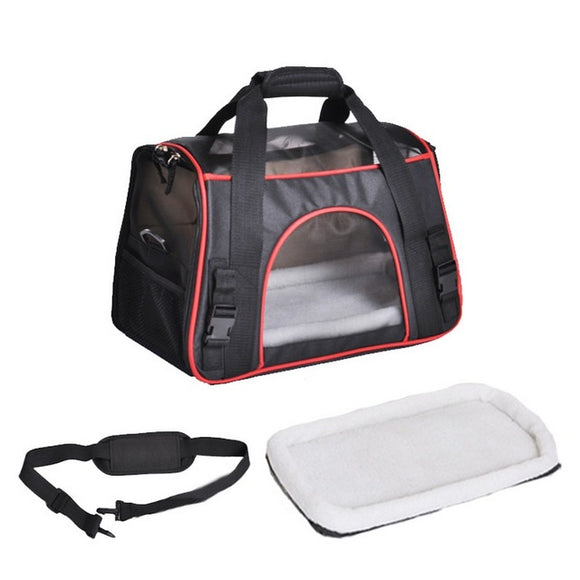 Duffle bag style pet carrier in black with red trim with removable shoulder strap and lining