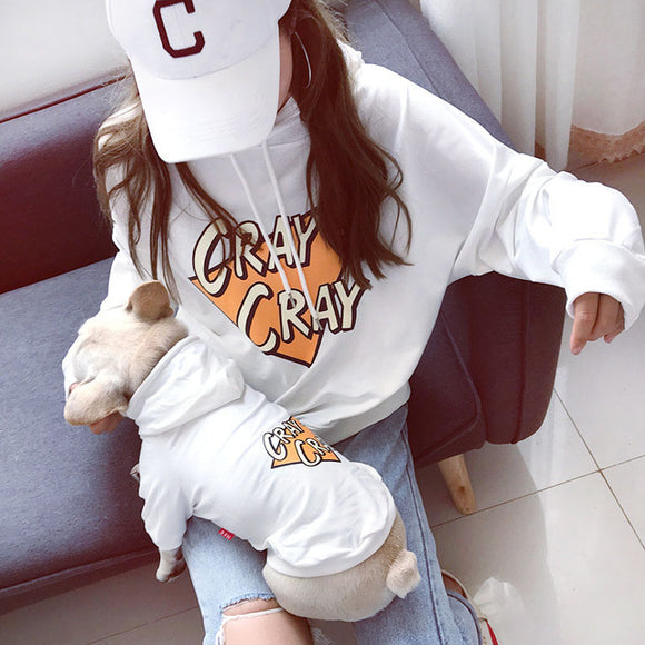 Human and dog matching Cray Cray hoodies in white