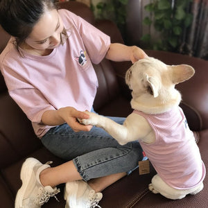 Human and dog matching striped shirts in pink