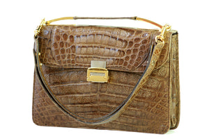 Tobacco brown crocodile skin handbag