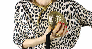 Golden egg clutch with wrist tassel