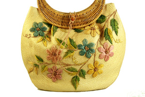 Straw purse bag with embroidered floral motif