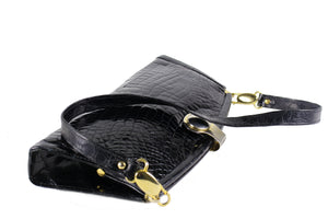 Black crocodile skin clutch with decorative brooch