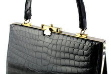 Black crocodile skin handbag with metallic frame