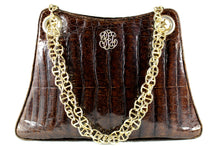 Large brown crocodile skin handbag with chain handle