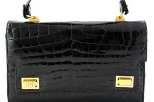 Jet black crocodile skin handbag with flap and double clasp