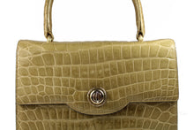 Toasted beige crocodile skin handbag with flap and single handle