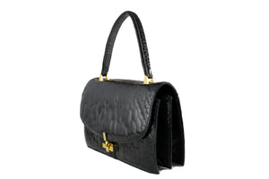Black turtle skin flap bag with top handle