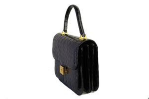 Jet black crocodile skin handbag with flap and decorative clasp