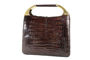 Brown crocodile skin handbag with decorative handles