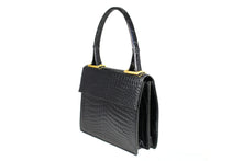 Jet black baby crocodile handbag with decorative handle