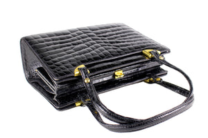 Black crocodile skin frame handbag with twin handles