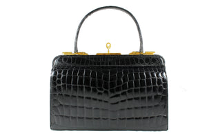 Black crocodile skin handbag with lined frame and key lock