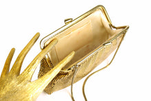 Gold mesh handbag with rhinestone clasp