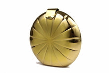 Metallic gold circular clutch with radial embossing