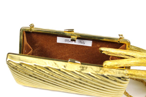 Gold metal clutch with diagonal engraving