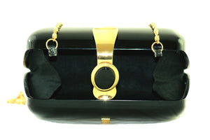 Black acrylic clutch with black brooch