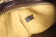 CHRISTIAN DIOR brown monogram canvas travel bag