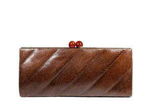 Elongated patchwork snakeskin clutch bakelite clasp