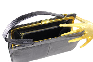Black lizard skin handbag