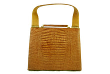 Caramel color lizard skin handbag