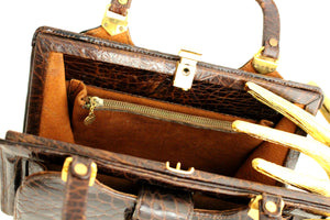 Small brown tortoise skin handbag with twin handles
