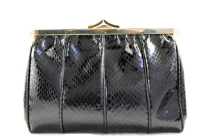 Black snake skin handbag with decorated frame