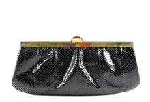 Black snake skin clutch with bakelite clasp