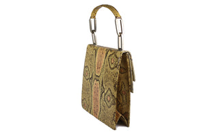 Pressed snake skin handbag in natural color