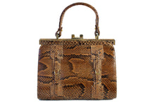 Snake skin handbag with lined frame and single handle