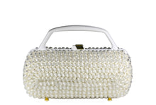 Cylindrical white beaded raffia handbag with clear beads