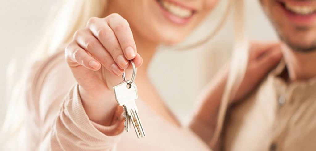 Woman holding keys with her partner