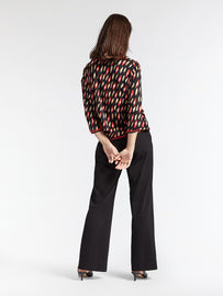 Top with all over print and lurex ribbing  -Red