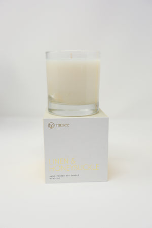 "Harmonious notes of fresh linen, bergamot, sweet pea and honeysuckle.  Quote inside box- ""All the darkness in the world can't extinguish a light from a single candle. "" -St. Francis of Assisi"