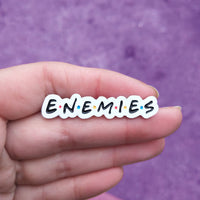 "Friends ""Enemies"" Enamel Pin"