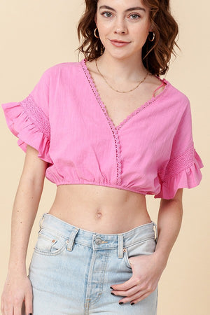 pink ruffled top