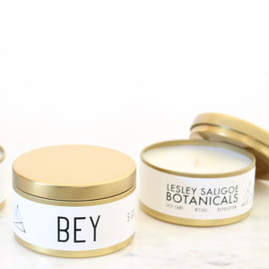 Small BEY Hand Poured Candle. Orange Marmalade. Honey. Bourbon. Clove. Wood Wick. 5 oz. Gold Tin.