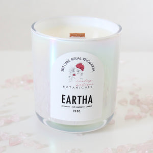 Eartha candle surrounded by rose quartz.