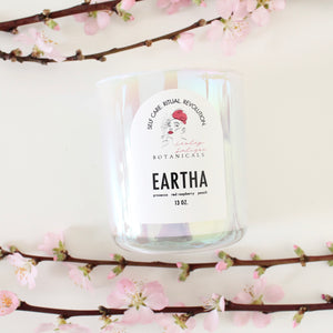 Lesley Saligoe Botanicals Eartha candle and pink flowering branches.