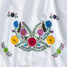 colorful embroidery from Mexican white dress