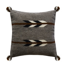 Gray pillow with brown arrows