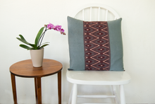 Accent gray pillow made on loom with brocade geometric pattern in burgundy