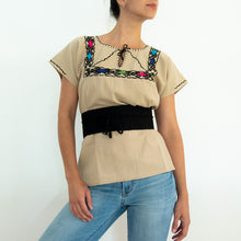 embroidered loose blouse beige and black waist band