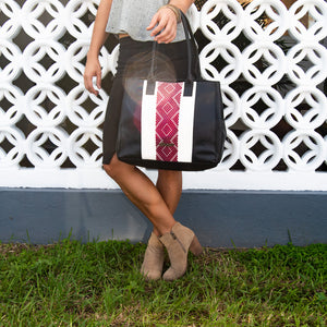 black leather bag, white and red loom insert, modeled.