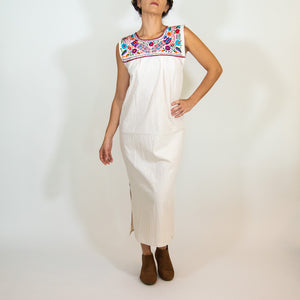 Mexican long white dress, multicolor embroidery, modeled