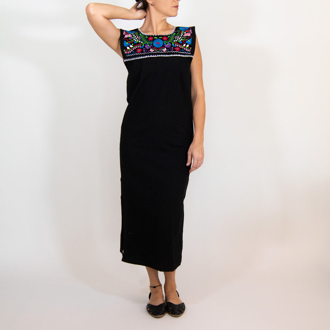 Mexican long black dress, multicolor floral embroidery, modeled