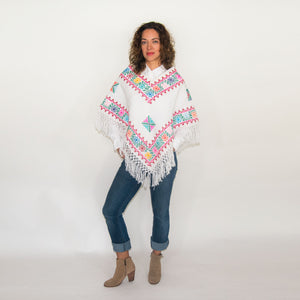 Folk Cape in White with Geometric Embroidery.