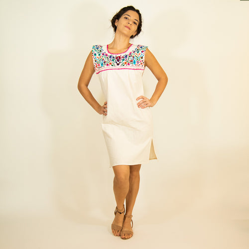 White loose Mexican dress, multicolor flower embroidery, modeled
