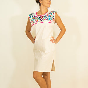 White loose Mexican dress, multicolor flower embroidery modeled