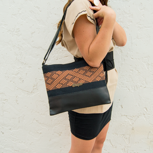 Black leather bag, black and brown loom insert, modeled.